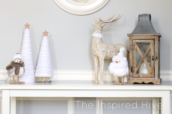 Make these easy and affordable DIY winter yarn trees to spruce up your winter decor! A great knock off idea to get the look for less!